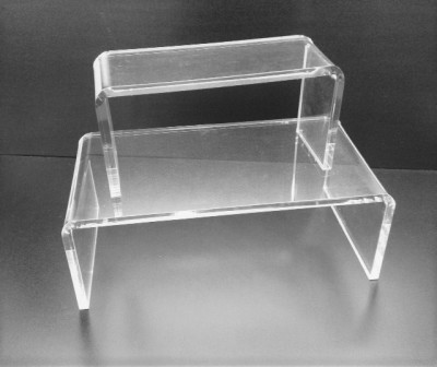 Add desk space with clear acrylic risers and stands.